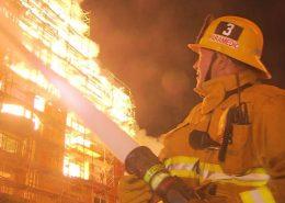 Fireman putting out construction fire